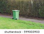 green wheelie bin isolated next ... | Shutterstock . vector #599003903