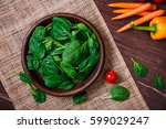 spinach leaves in bowl. carrot  ... | Shutterstock . vector #599029247