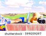 creative man using laptop in... | Shutterstock . vector #599059397