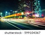 modern urban traffic at night | Shutterstock . vector #599104367