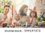 mother  father and daughters... | Shutterstock . vector #599197373
