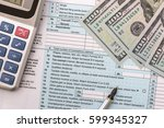 1040 tax form with calculator ... | Shutterstock . vector #599345327
