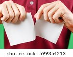 man tearing a piece of paper in ... | Shutterstock . vector #599354213