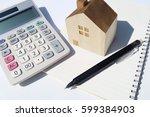 calculator home pen notebook | Shutterstock . vector #599384903