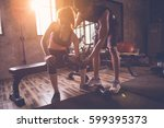 sporty girl doing weight... | Shutterstock . vector #599395373