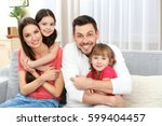 happy family on sofa in the room | Shutterstock . vector #599404457