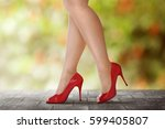 woman legs in red high heels... | Shutterstock . vector #599405807