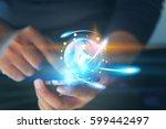 hand holding glowing globe.... | Shutterstock . vector #599442497