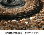 coins thrown to a fountain  in...