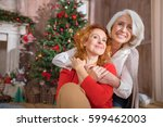 two women embracing sitting on... | Shutterstock . vector #599462003