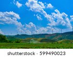 clouds float over mountains and ... | Shutterstock . vector #599490023