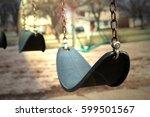 Empty Swings In A  Light.