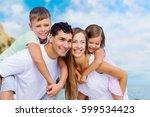 family on the beach. | Shutterstock . vector #599534423
