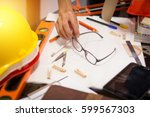 architect working on blueprints ... | Shutterstock . vector #599567303