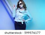 fashion model in sunglasses ... | Shutterstock . vector #599576177