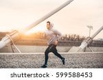 young man running in urban... | Shutterstock . vector #599588453