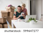 young couple moving in a new... | Shutterstock . vector #599647277