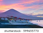 fishing boats on the beach and... | Shutterstock . vector #599655773