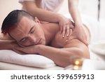 positive young man having a... | Shutterstock . vector #599659913