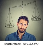 Small photo of Man making a decision with scale above head and people on a balance. Power, opinion, self importance concept. Human face expression, emotions