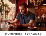 professional young man sitting... | Shutterstock . vector #599710163