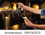 Bartender Pouring From Tap...