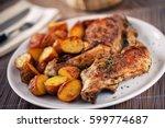 roast chicken with potatoes on... | Shutterstock . vector #599774687