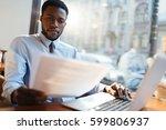 serious employer reading... | Shutterstock . vector #599806937