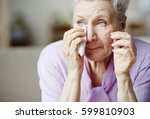 grandmother wiping tears with... | Shutterstock . vector #599810903