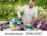 young man pouring red homemade... | Shutterstock . vector #599814557