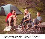 family near the bonfire in the... | Shutterstock . vector #599822243