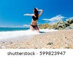 beautiful young woman sitting... | Shutterstock . vector #599823947
