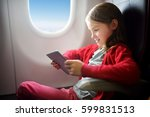 adorable little girl traveling... | Shutterstock . vector #599831513