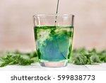 green chlorophyll drink in... | Shutterstock . vector #599838773