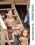 Small photo of Luang Namtha prov., Laos-October 6, 2015: The Akha hill tribe are an ethnic minority living in the mountains between E.Myanmar-N.Thailand-W.Laos-S.China. Locals greet the tourists visiting the village