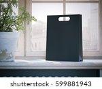 black shopping bag on a wooden... | Shutterstock . vector #599881943