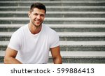 young man smiling with perfect... | Shutterstock . vector #599886413