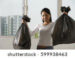 young asian woman holding up...   Shutterstock . vector #599938463