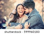 happy young couple hugging and... | Shutterstock . vector #599960183