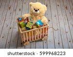 teddy bear holding toy blocks ... | Shutterstock . vector #599968223