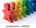 Diversity - colorful, wooden people standing in a line. - stock photo