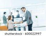 handshake between lawyer and... | Shutterstock . vector #600022997