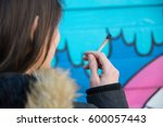 girl smoking a joint | Shutterstock . vector #600057443