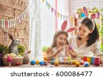 mother and her daughter... | Shutterstock . vector #600086477