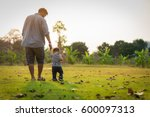 happy father and little boy... | Shutterstock . vector #600097313