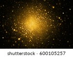 abstract golden sparkles on... | Shutterstock . vector #600105257