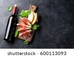 fresh melon with prosciutto and ... | Shutterstock . vector #600113093