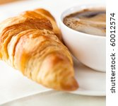Croissant And A Cup Of...