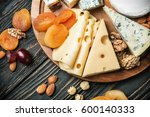 assorted cheeses with nuts and... | Shutterstock . vector #600140333