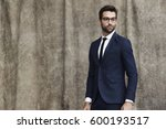 suited man in eyeglasses ... | Shutterstock . vector #600193517